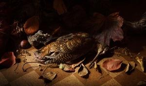 Bécasse des dieux cuite sur une tresse d'ail fumé d'Arleux, jus d'oiseau au long bec
